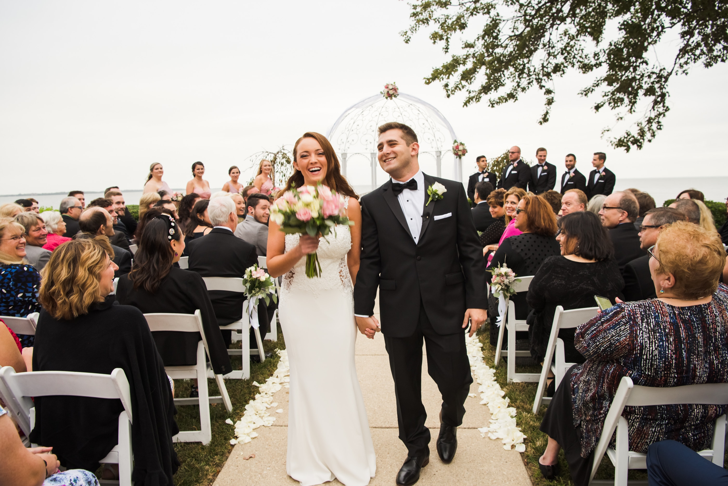 A Couple Walks down the isle on a outdoors